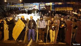 Pro-EU protesters guard a barricade near the Independence Square in Kiev. Photo: 15 December 2013