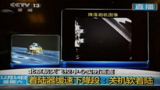 """This screen grab taken from CCTV live broadcasting footage shows an image (R) of China""""s first lunar rover transmitted back to the control centre in Beijing after it landed on the moon on December 14, 2013."""