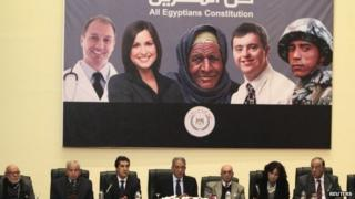 Poster advertising Egypt's draft constitution at a news conference in Cairo (15 December 2013)