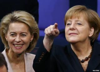 Angela Merkel (right) with designated Defence Minister Ursula von der Leyen in the Bundestag, Berlin, 17 December