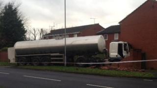 Milk tanker hits house
