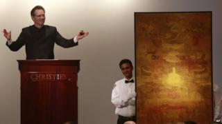 """Christie's International Director, Asian Art, Hugo Weihe, left, acts as auctioneer for the painting of Indian artist Vasudeo S. Gaitonde during Christie""""s first auction in India in Mumbai, Thursday, Dec. 19, 2013."""
