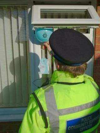 Police officer putting balloon through open window