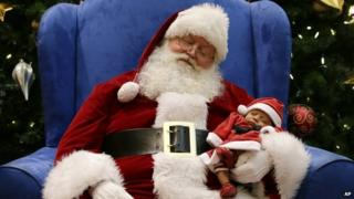 Santa and sleeping baby