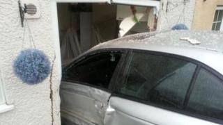 car in side of house