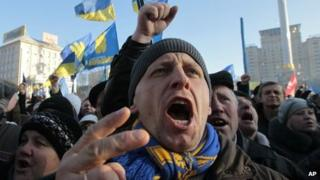 A pro-European Union activist shouts a slogan during a rally in Independence Square in Kiev, Ukraine, on Sunday
