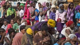 Displaced people queue at a UN camp in Malakal where they are seeking shelter 30/12/2013