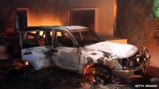 Fires burn in the US Benghazi consulate the day after it was attacked by Libyan militants in 2012.