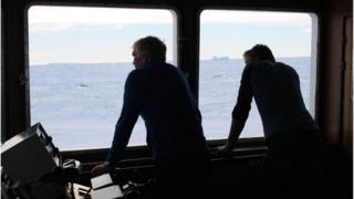 Expedition leader Greg Mortimer and Ben Fisk on bridge