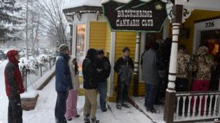 A line waits outside the Cannabis Club on Main Street in downtown Breckenridge, Colorado, for an 8:00 opening of the store 1 January 2014