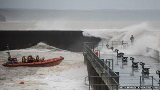 Aberystwyth lifeboat reaches the 21-year-old man taking photos on the jetty