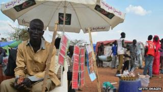 A man sells phone cards at a displaced persons' camp in Juba