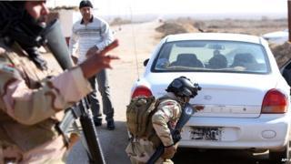 military checking car at border