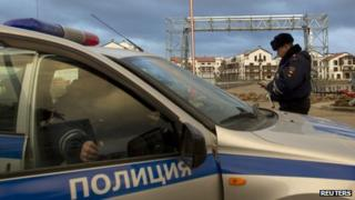 Russian police patrol near accommodation sites and venues in the Olympic Park near Sochi