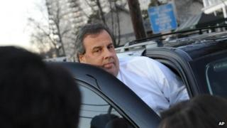 New Jersey Governor Chris Christie leaves after a visit to Fort Lee City Hall 9 January 2014