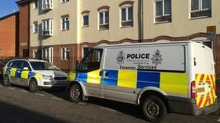 Police vehicles outside flat in Dillwyn Street, Ipswich