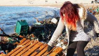 A volunteers collecting rubbish on Chesil Beach