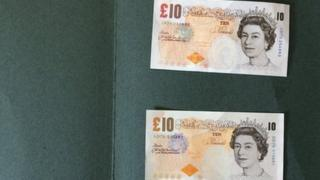 Real £10 note, above, and fake £10 note below