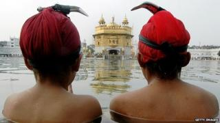 Sikh devotees by the Golden Temple of Amritsar