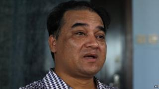 Outspoken Uighur scholar and advocate Ilham Tohti speaks during an interview at his home in Beijing on 5 July 2013
