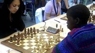 Phiona (right) in action at the 2010 chess Olympiad in Siberia