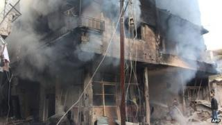 Smoke rises from a damaged building in Daraya, Syria. Photo: 12 January 2014