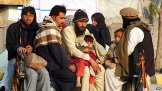 "Internally displaced Pakistani civilians, fleeing from military operations against Taliban militants in North Waziristan, arrive in Bannu, a town on the edge of Pakistan""s lawless tribal belt of Waziristan on January 21, 2014."
