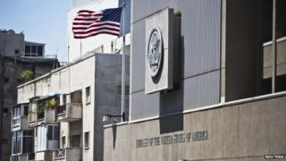 A flag flutters outside the US embassy in Tel Aviv