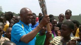Kip Keino with the Queen's Baton