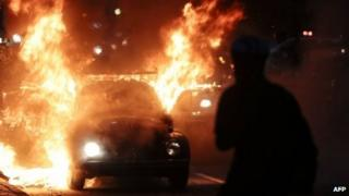 A car burns in flames during in Sao Paulo, Brazil, on January 25, 2014.