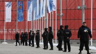 Russian police officers stand guard at the Olympic Park in the Adler district of Sochi, January 26, 2014