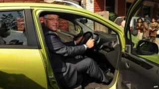Karl Slym poses during the launch of a motor car in India in January 2010