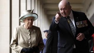 Britain's Queen Elizabeth II (left) is accompanied by retired General Peter Cosgrove, chairman of the Australian War Memorial Board, as she walks the cloisters at the Australian War Memorial in Canberra on 25 October 2011