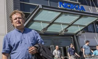 Staff leave a Nokia building in 2012 after a briefing to announce redundancies