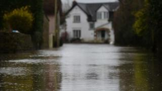 House at the end of a flooded street