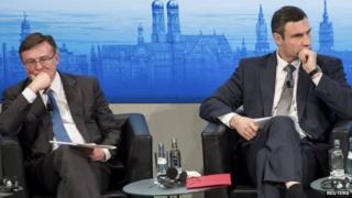 Ukrainian Foreign Minister Leonid Kozhara (left) and opposition leader Vitali Klitschko