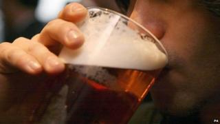 A man drinking a pint