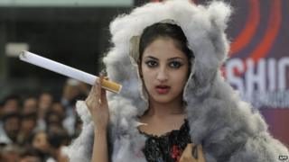 Indian students showcase designs related to cancer prevention for World Cancer day in Hyderabad on February 4, 2013