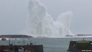 Waves crash in Alderney