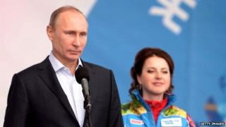 Vladimir V Putin, standing with figure skater Irina Slutskaya