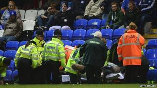 Play is stopped due to an illness to a fan in the crowd during the Johnstone's Paint Southern Area Final between Peterborough United and Swindon Town at London Road