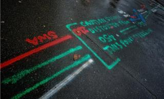 green, red, blue and white markings on a road in Essex