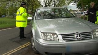 police officer taking to motorist