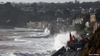 Waves crash over the main Exeter to Plymouth railway line that has been closed due to parts of it being washed away by the sea on February 8, 2014