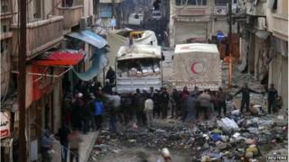 Red Crescent trucks deliver aid in Homs