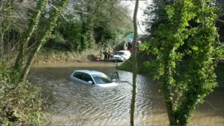 A car stuck in floodwater in Kent
