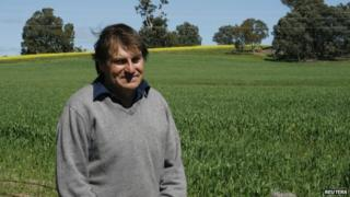 File photo: West Australian organic farmer Steve Marsh at the fence line of his property and his neighbour Michael Baxter's genetically-modified canola farm in Kojonup, 10 September 2011