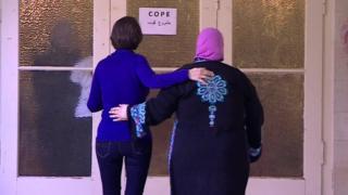 Ruth Ebenstein and Ibtisam Erekat enter a COPE breast-cancer support meeting in Jerusalem
