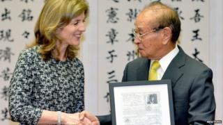 US envoy Caroline Kennedy shakes hands with Okinawa Governor Hirokazu Nakaima in Okinawa, 12 February 2014
