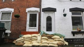 A house protected by sandbags in Alney Terrace on Alney Island, Gloucester